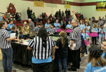 Blossomwood Robotics Team members watch as another group competes at the state tournament.