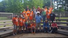 Weatherly Assembly of God volunteers on the outdoor classroom seating, after a hard day's work