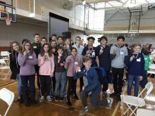 Students from CMS at the Huntsville Technology Fair at UAH holding their medals
