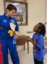 Child asking NASA astronaut questions about the space station