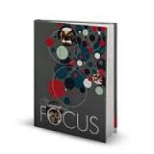 Sample cover of yearbook displaying concentric circles on a dark gray background and the text: Focus
