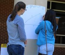 Two of Mr. Thornton's students working on trig together in the courtyard.