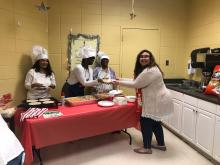 Ms Floyd 2nd grade teacher being served by office staff