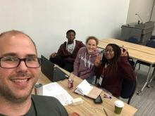 Mr. Archer snaps a selfie with students participating in Space Apps.