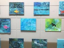 Student paintings flow technique scenes of underwater using acrylics and other recycled items