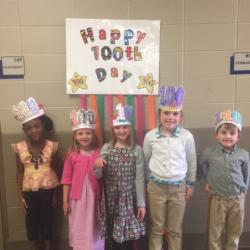 Blossomwood first graders wearing 100th day hats.