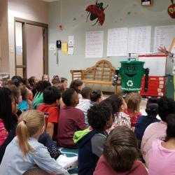 A representative from Operation Green Team reading to our first graders