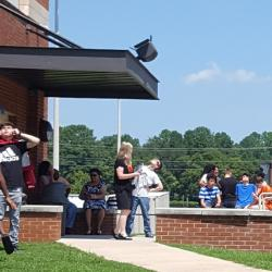 Students enjoying the solar eclipse outside.
