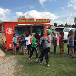 Students lined up in front of sno cone truck