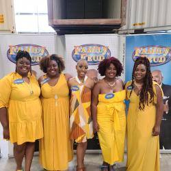 4th grade teacher, Ms. Rose, (second on the left) with her family competing on Family Fued.