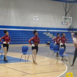 Dancing Wildcats performing for the students.
