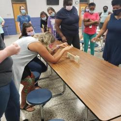 Teachers working together on a team-building activity