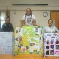 6th grade science fair winners standing by their projects