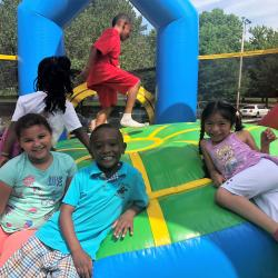 kindergarten students smiling in the bounce house