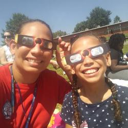One of our students viewing the eclipse with her aunt.