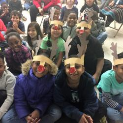 Students wearing Rudolph the Red-Nosed Reindeer headbands at the Montview Holiday Program