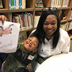 "a grandmother with her grandson who is holding up his coloring sheet that says ""I'm a Mustang!"" at K for a Day"