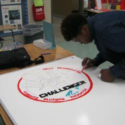Middle sSchool students recreated mission patches for each whiteboard