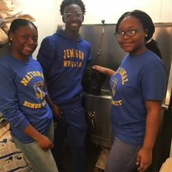 Three Jemison NHS Members stand in front of large sink.