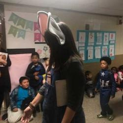 PreK students in character parade and teacher with mouse ears