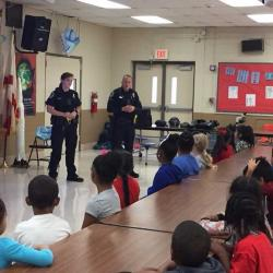 Police officers speaking to first grade students