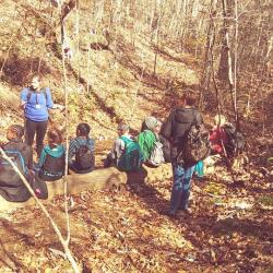 Student Nature Lecture in the woods at Camp McDowell