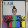 The image to the right shows sophomore, Hannah S., displaying two of her paintings