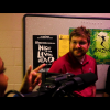 Live filming of two people in a hallway.