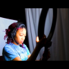 Student working with a studio ring light.