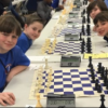 Members of the Blossomwood Chess Club compete in the tournament.