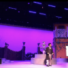 View A theatre set with a purple background.