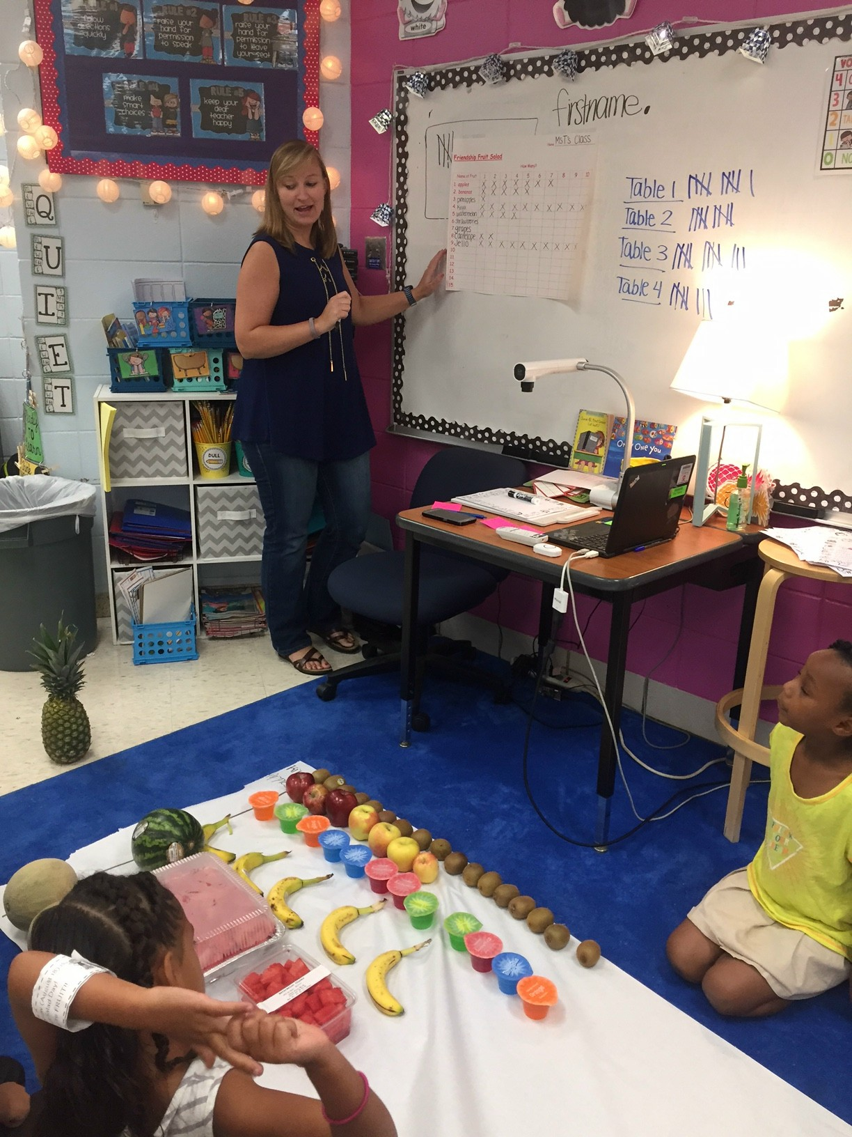 First Grade teacher graphing fruit with students
