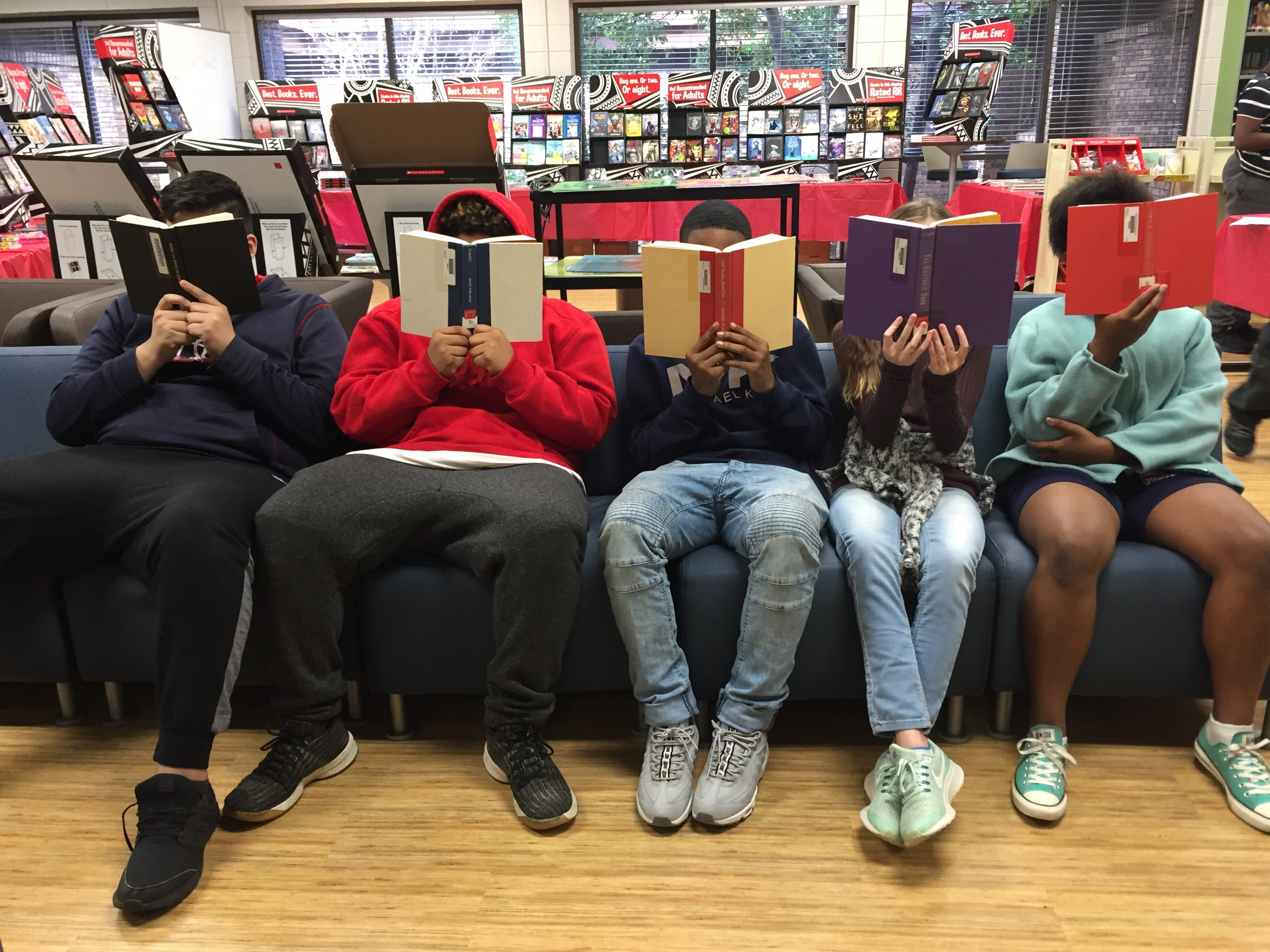 Image of students reading books in the library.
