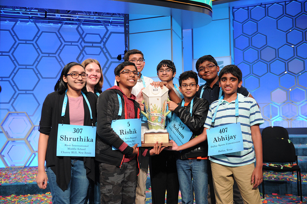 """2019 Scripps National Spelling Bee """"Octochamps"""" holding their trophy together"""