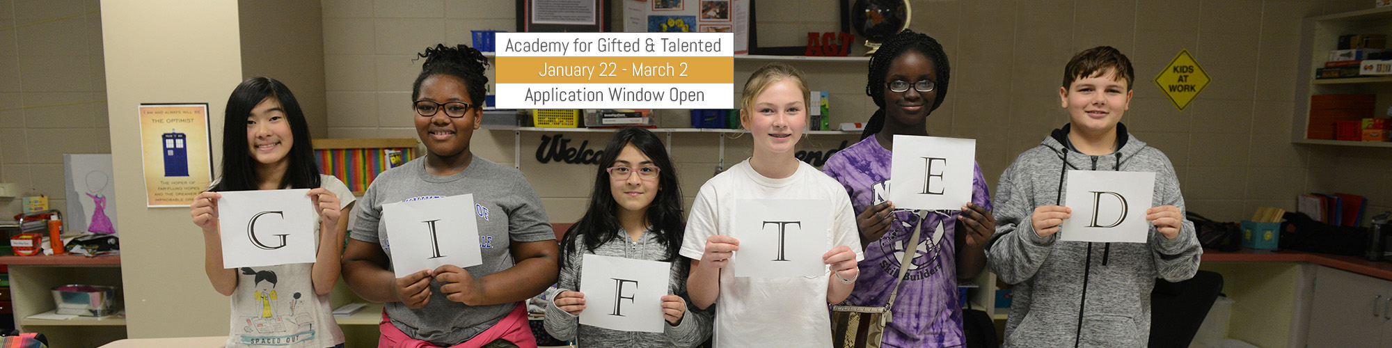 Students holding up letters that spell GIFTED, Academy for Gifted & Talented Application Window open from January 22nd until March 2nd