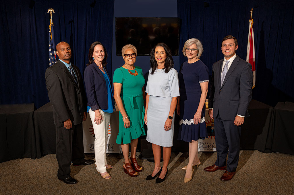 2021 Board of Education standing in the board room with Superintendent Finley