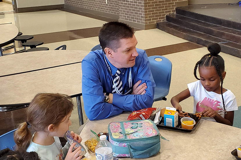 Dr Bradley Scott speaking to kindergarten students in the cafeteria