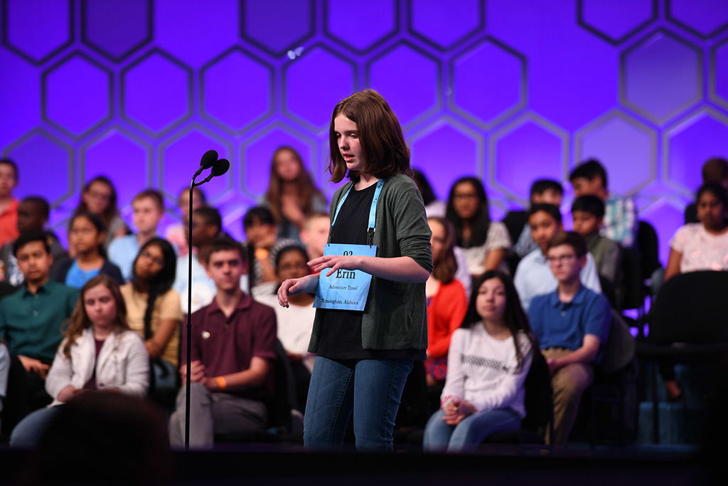 Erin Howard typing on an imaginary keyboard while spelling at the 2019 Scripps National Spelling Bee