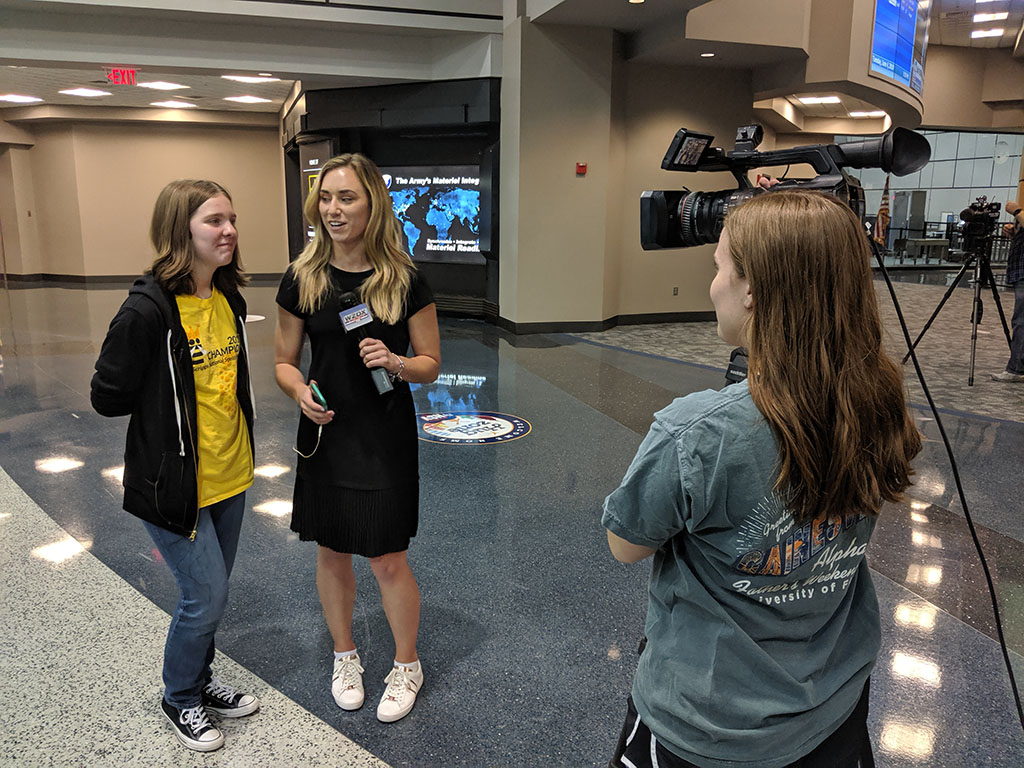 Erin being interviewed by WZDX after landing in Huntsville again