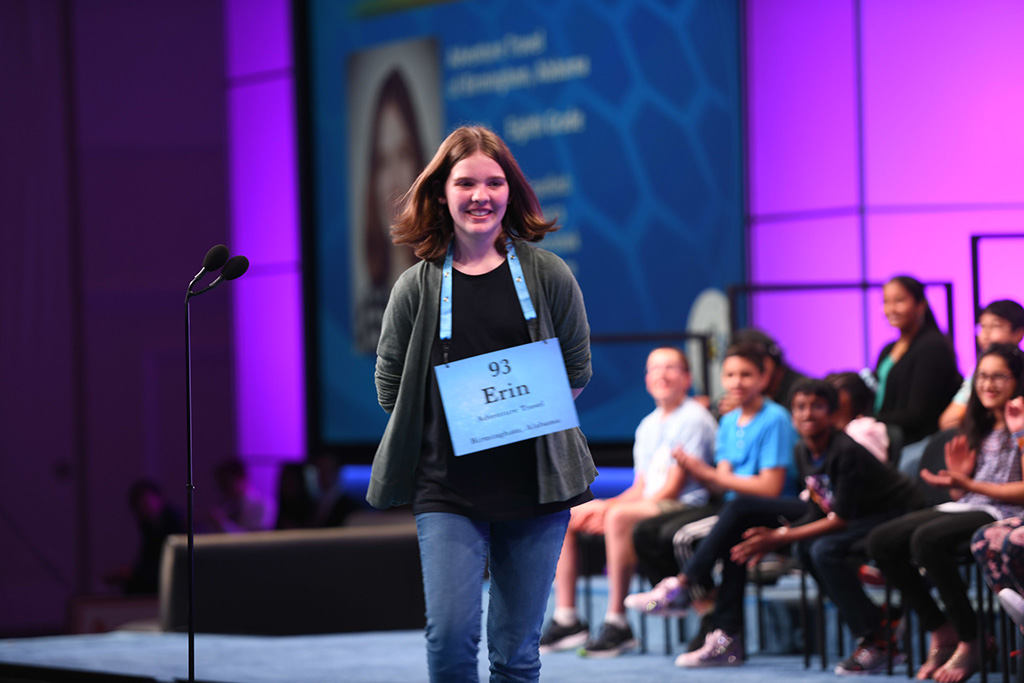 Erin smiling as she walks away from the mic at the 2019 Scripps Spelling Bee