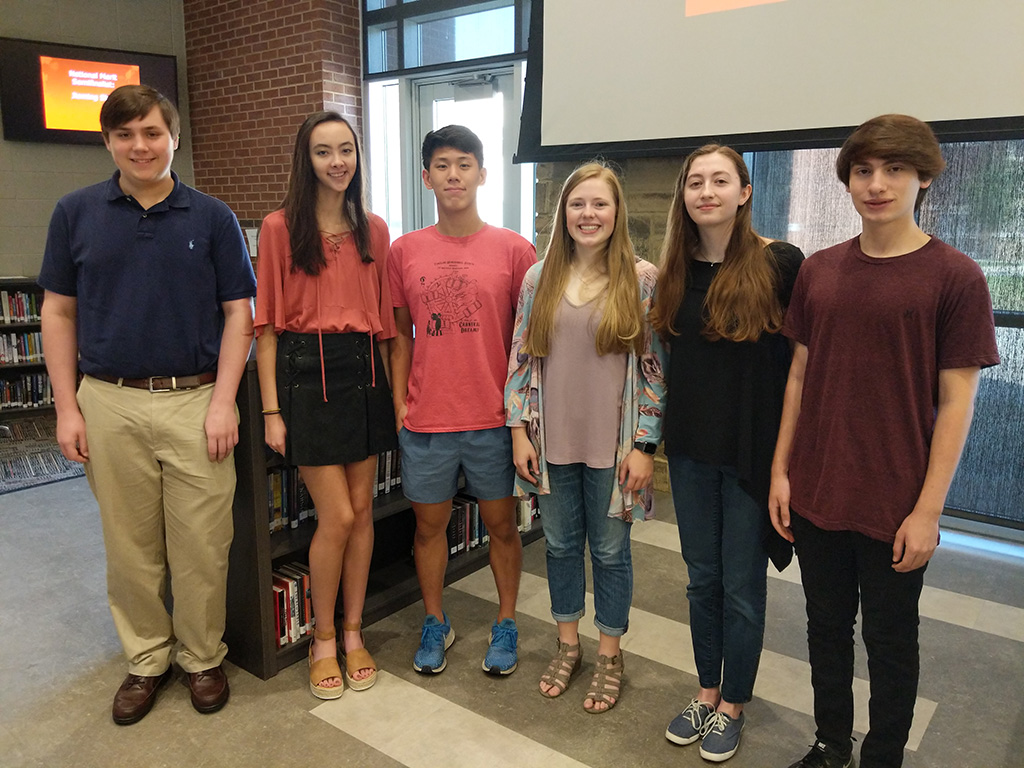 Six Grissom High Seniors (3 boys 3 girls) standing in lobby after being recognized as National Merit Semifinalists