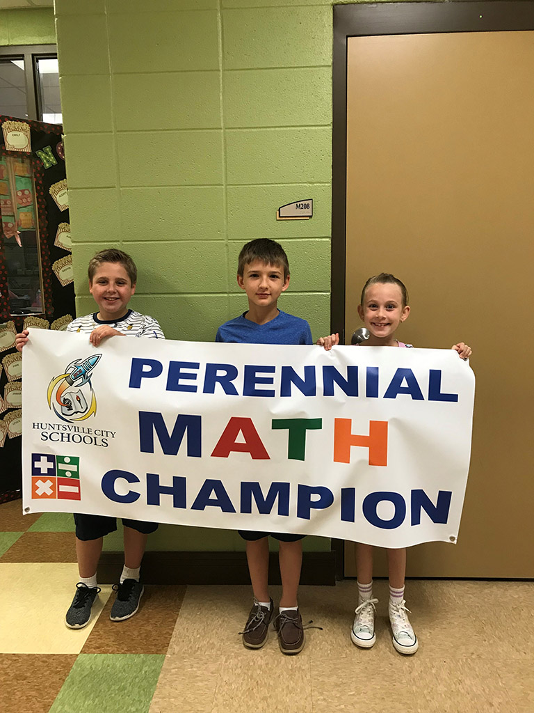 Second group of 3rd Grade Champions from Goldsmith Schiffman Elementary Holding a Math Competition Sign