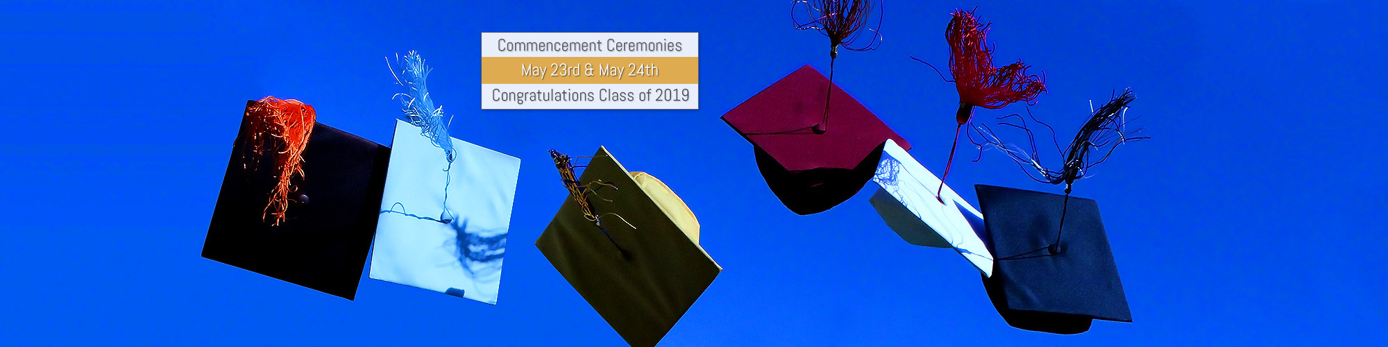 Graduation caps from each high school thrown into the air, text which reads commencement ceremonies, may 23 and may 24, congratulations class of 2019
