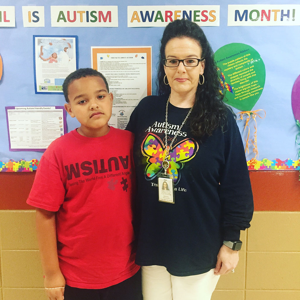 A teacher at Jones Valley Elementary poses with her student for Autism Awareness Day