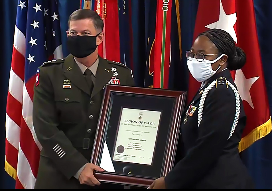 Ketty-Daphne Ngwese reciving the Bronze Cross award from Deputy Commander Lt. Gen. Flem B. Walker Jr