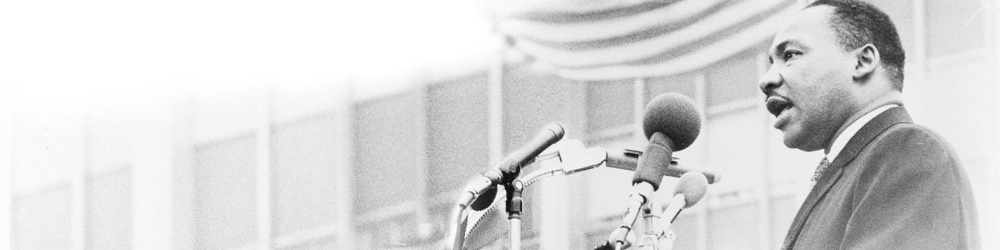 Dr. King speaking at a podium
