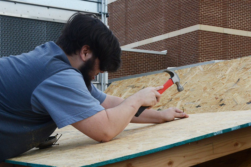 NCTHS Student Hammering a Nail