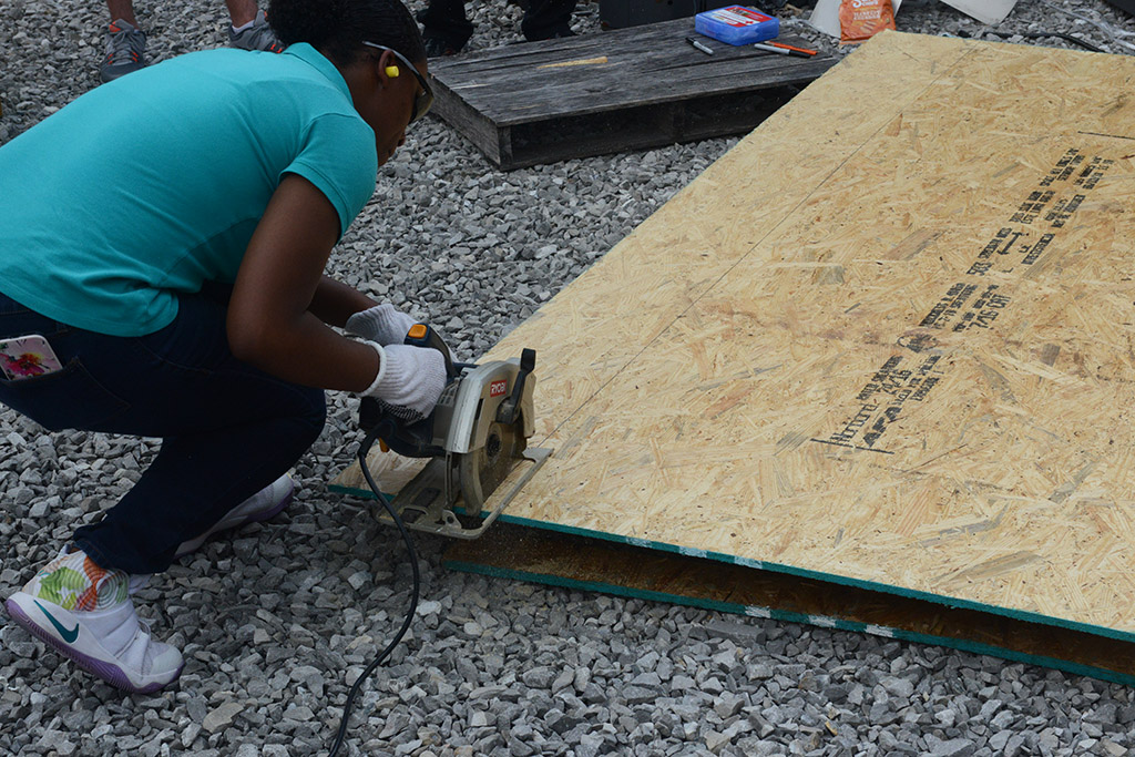 NCTHS Student Sawing Pressboard