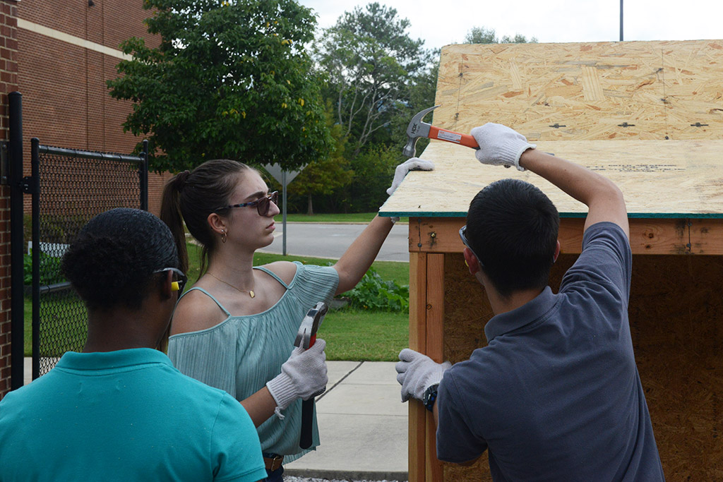 NCTHS Students Hammering Nails on Playhouse