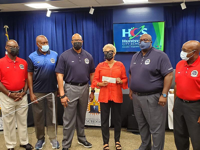 Representatives of NOBLE present a check for school supplies to District 1 Representative Michelle Watkins